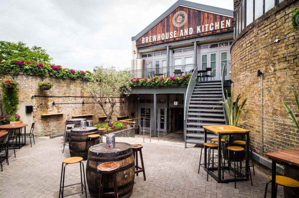 An exterior photo of Brewhouse & Kitchen in Highbury, showing their outside seating area.